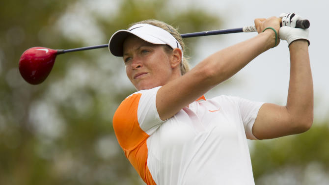 Suzann Pettersen of Norway, watches her drive off the second tee during the third round of the LPGA Lotte Championship golf tournament at the Ko Olina Golf Club Friday, April 19, 2013, in Kapolei, Hawaii. (AP Photo/Eugene Tanner)
