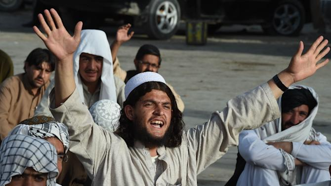 Members of the Pakistani Jamiat Nazriati party shout slogans in a rally to pay tribute to Afghanistan's deceased Taliban chief Mullah Omar, in the southwestern city of Quetta on August 2, 2015