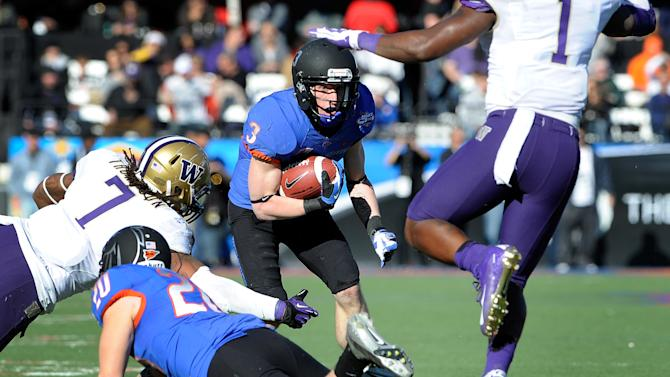 Boise State's Chris Potter (3) looks for an opening during first half of the MAACO Bowl NCAA college football game against Washington, Saturday, Dec. 22, 2012, in Las Vegas. (AP Photo/David Becker)