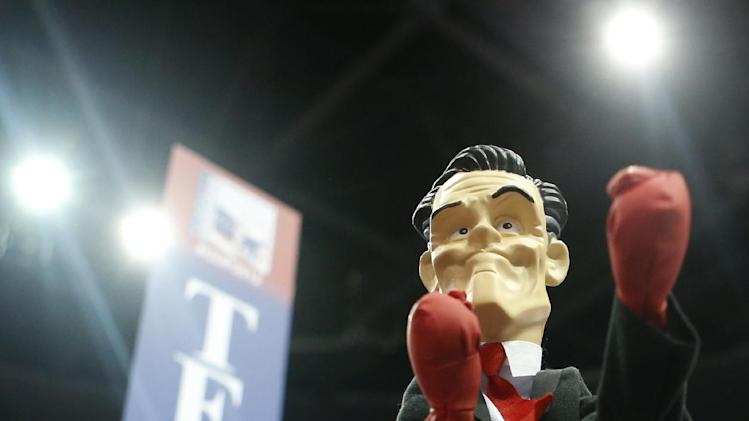 Texas delegate Patrick O'Daniel from Austin fashions a fighting doll of Republican presidential nominee Mitt Romney on his hand during the Republican National Convention in Tampa, Fla., on Wednesday, Aug. 29, 2012. (AP Photo/Jae C. Hong)