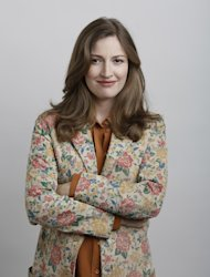 "In this June 18, 2012 photo, actress Kelly Macdonald poses for a portrait during the ""Brave"" press day at Loews Hollywood Hotel, in Los Angeles. The top spot at the box office is rare turf for Kelly Macdonald, a character actress known on the big-screen mainly for supporting roles in such films as ""No Country for Old Men"" and ""Finding Neverland."" With her wild red mane and her killer skills with sword and bow, Macdonald has become the latest in Hollywood's growing line of successful female action heroes. (Photo by Todd Williamson/Invision/AP)"