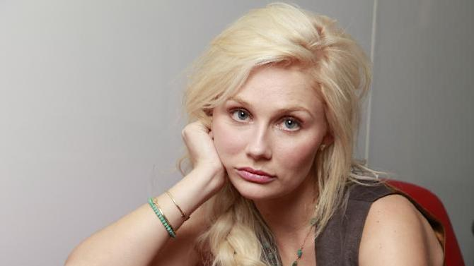 """In this Nov. 19, 2012 photo, Australian actress and singer Clare Bowen, who stars as Scarlett O'Connor in the ABC drama series """"Nashville,"""" poses for a photo in Los Angeles.  The music of """"Nashville"""" has been as much a star on the hourlong ABC drama as Connie Britton, Hayden Panettiere, Charles Esten, Jonathan Jackson, Bowen and Sam Palladio. Yes, each really does sing his or her own part, and so far fans seem to be responding, buying more than 800,000 digital singles. (AP Photo/Damian Dovarganes)"""
