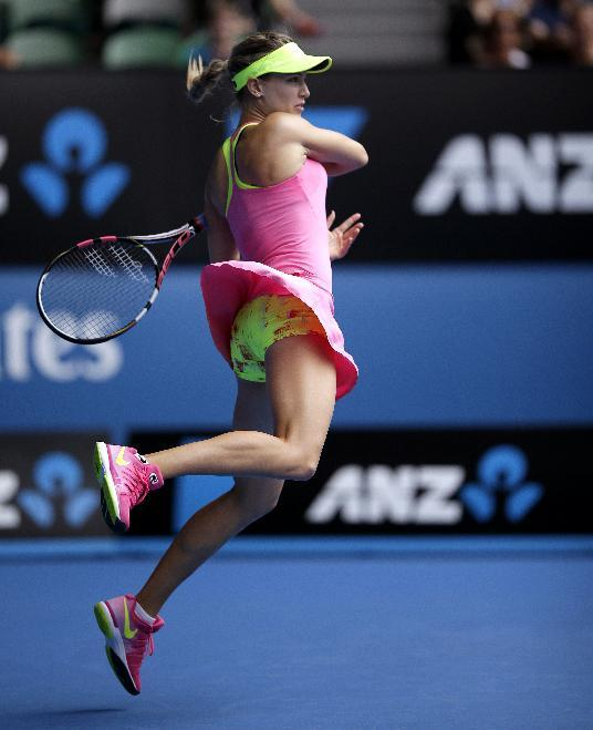Eugenie Bouchard of Canada plays a shot to Maria Sharapova of Russia during their quarterfinal match at the Australian Open tennis championship in Melbourne, Australia, Tuesday, Jan. 27, 2015. (AP Photo/Bernat Armangue)