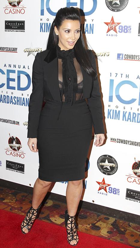 Kim Kardashian Embraces Pregnancy Curves in Sheer Shirt, Black Bra: Picture