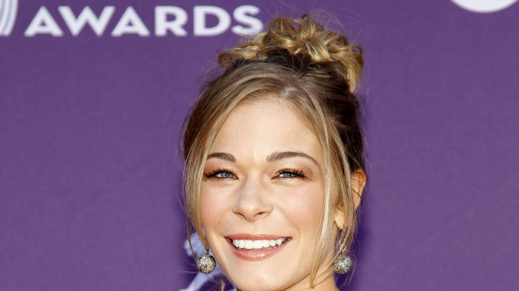 FILE - This April 1, 2012 file photo shows country singer and actess LeAnn Rimes arriving at the 47th Annual Academy of Country Music Awards in Las Vegas. Rimes is getting professional help for anxiety and stress. Her publicist, Marcel Pariseau, says Rimes has voluntarily entered a 30-day in-patient treatment facility. He says Rimes isn't seeking treatment for an eating disorder or substance abuse. The 30-year-old Rimes checked into the facility Wednesday, Aug. 29. (AP Photo/Isaac Brekken, file)