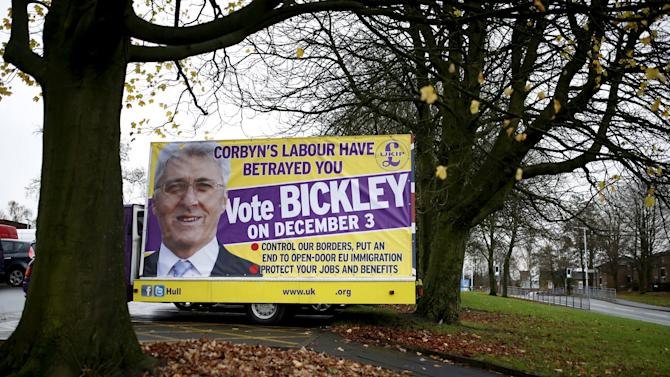A poster featuring UKIP party candidate John Bickley stands in a car park outside Royton Market near Oldham northern England