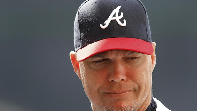 Atlanta Braves third baseman Chipper Jones announces that he will retire following the 2012 season during a news conference before a spring training baseball game against the Miami Marlins in Kissimmee, Fla., Thursday, March 22, 2012.  (AP Photo/Paul Sancya)