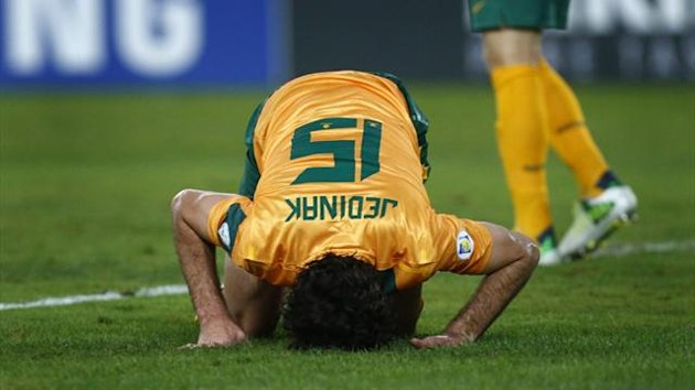 Australia's Mile Jedinak reacts after Oman scored during their World Cup qualifier in Sydney (Reuters)