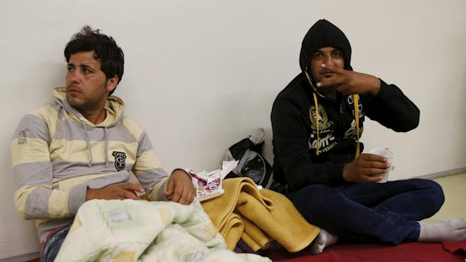 Migrants sit in a refugee reception centre after arriving from Hungary, in Nickelsdorf, Austria