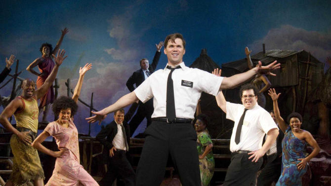 """FILE - In this file theater publicity image provided by Boneau/Bryan-Brown, Andrew Rannells, center, performs with an ensemble cast in """"The Book of Mormon"""" at the Eugene O'Neill Theatre in New York. Most Broadway shows had a lot to be thankful for this Thanksgiving; box offices jumped more than $6 million from the previous week. Some of the biggest winners were """"The Book of Mormon"""" and """"Annie,"""" which both set house records.  (AP Photo/Boneau/Bryan-Brown, Joan Marcus, File)"""