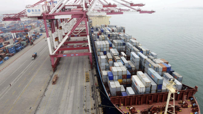 In this photo taken Monday July 8, 2013, a ship is docked at a container port in Qingdao in eastern China's Shandong province. China reported Wednesday, July 10, 2013 that imports and exports both fell abruptly in June. The statistics are a new sign of weakness in the world's second-largest economy. (AP Photo) CHINA OUT