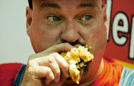 "Dale ""Mouth of the South"" Boone chokes down another hamburger during Z-Burger's 4th Annual Independence Burger Eating Contest in Washington, but he did not come in first. A one-time anorexic from Toronto turned world-class competitive eater clinched his fourth straight hamburger title in Washington on Tuesday on the eve of New York's iconic hot dog classic"