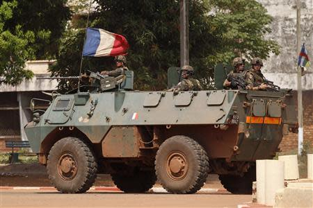 French soldiers patrol in their armoured personnel carrier (APC) during fighting in Bangui