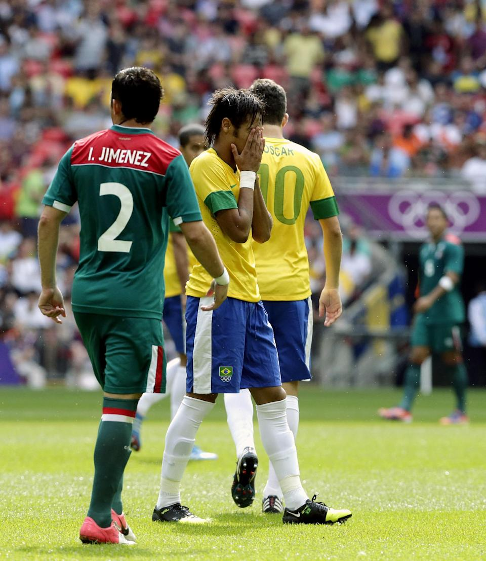 Brazil's Neymar, center, reacts as Mexico's Israel Jimenez (2) walks by during the men's soccer final at the 2012 Summer Olympics, Saturday, Aug. 11, 2012, in London. (AP Photo/Luca Bruno)