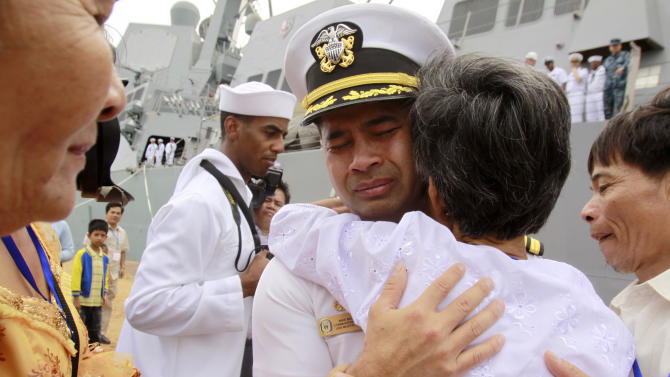 "In this photo taken Dec. 3, 2010, U.S. navy officer Michael ""Vannak Khem"" Misiewicz becomes emotional as he embraces his aunt Samrith Sokha, 72, at Cambodian coastal international see port of Sihanoukville, Cambodia. Misiewicz passed confidential information on ship routes to Malaysian businessman Leonard Francis' Singapore-based company, Glenn Defense Marine Asia Ltd., or GDMA, according to the court documents. Misiewicz and Francis moved Navy vessels like chess pieces, diverting aircraft carriers, destroyers and other ships to Asian ports with lax oversight where Francis could inflate costs, according to the criminal complaint. The firm overcharged the Navy millions for fuel, food and other services it provided, and invented tariffs by using phony port authorities, the prosecution alleges. (AP Photo/Heng Sinith, File)"