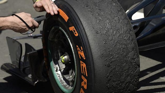 The tyres on Mercedes Formula One driver Nico Rosberg of Germany's car are checked by an official after the British Grand Prix at the Silverstone Race circuit (Reuters)