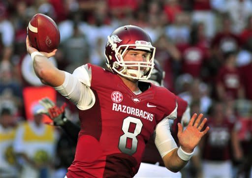 Wilson leads Arkansas by Jacksonville State 49-24