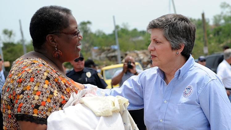 U.S. Department of Homeland Security Secretary Janet Napolitano speaks with Stephanie Anderson, who came to collect items belonging to her 72-year-old mother, Bessie Brewster, who was killed in the storm, Sunday, May 1, 2011, in Birmingham, Ala. (AP Photo/The Birmingham News, Michelle Campbell) MAGS OUT; NO SALES