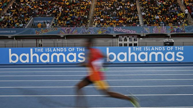 A runner is seen in a slow shutter speed photograph as he runs in the men's Distance Medly Relay race at the IAAF World Relays Championships in Nassau