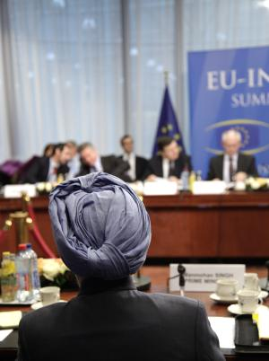 Indian Prime Minister Manmohan Singh, foreground, listens to EU leaders during an EU-India summit at the EU Council building in Brussels, Friday, Dec. 10, 2010. (AP Photo/Virginia Mayo)