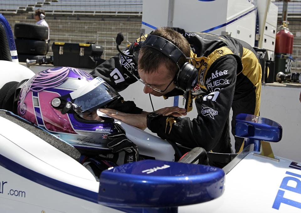 IndyCar driver Katherine Legge, of England, talks with teammate Sebastien Bourdais, of France, after she took her first laps during practice for the Indianapolis 500 auto race at the Indianapolis Motor Speedway in Indianapolis, Thursday, May 17, 2012. (AP Photo/Darron Cummings)