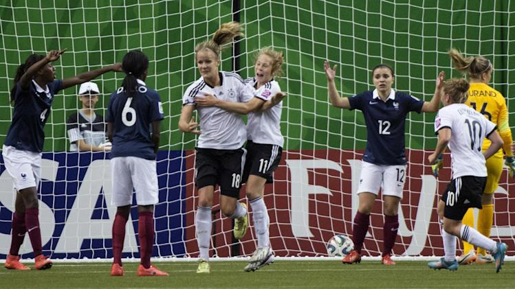 Germany's Lena Petermann (18) celebrates her goal against France with teammate Theresa Panfil during the second half of a FIFA U-20 women's World Cup semifinal in Montreal on Wednesday, Aug. 20, 2014. Germany won 2-1. (AP Photo/The Canadian Press, Paul Chiasson)