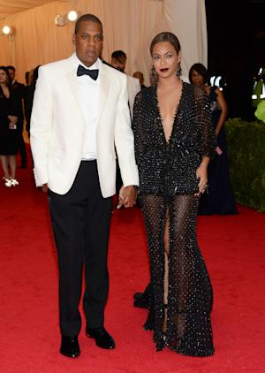 "FILE - This May 5, 2014 file photo shows Jay Z, left, and Beyonce at The Metropolitan Museum of Art's Costume Institute benefit gala celebrating ""Charles James: Beyond Fashion"" in New York. The Standard Hotel in New York City says it is investigating the leak of a security video that appears to show Beyonce's sister, Solange, attacking Jay Z. Asked about the video on Monday, May 12, by The Associated Press, the hotel issued a statement saying it is ""shocked and disappointed that there was a clear breach of our security system."" (Photo by Evan Agostini/Invision/AP, File)"