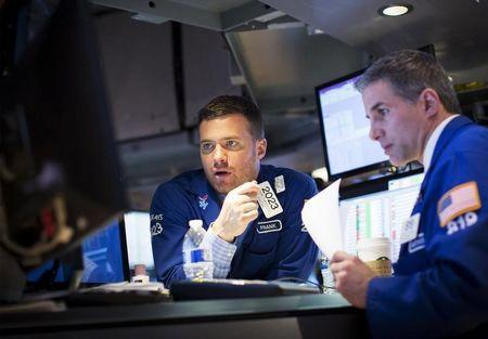Global funds raise U.S. equity holdings, eye emerging markets for 2016 bounce