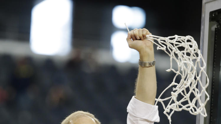 Michigan head coach John Beilein reacts after cutting down the net after a regional final game against Florida in the NCAA college basketball tournament, Sunday, March 31, 2013, in Arlington, Texas. Michigan won 79-59 to advance to the Final Four. (AP Photo/Morry Gash)