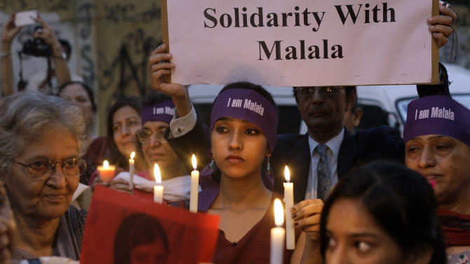 Pakistanis hold candles during a protest to condemn the attack on of 14-year-old schoolgirl Malala Yousufzai, who was shot on Tuesday by the Taliban for speaking out in support of education for women, in Karachi, Pakistan, Thursday, Oct. 11, 2012. (AP Photo/Shakil Adil)
