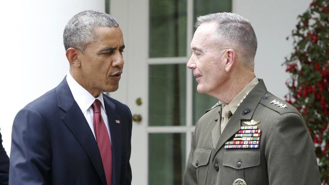 U.S. President Obama greets Marine Corps' Commandant Dunford after nominating Dunford to be the next Joint Chiefs chairman at the White House in Washington