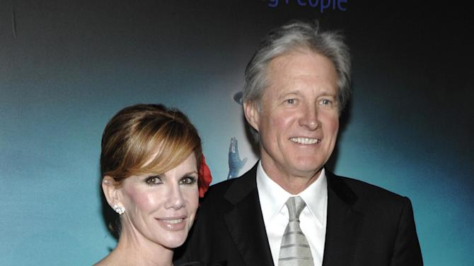 "FILE - In this Dec. 11, 2010 file photo, actor Bruce Boxleitner, right, and actress Melissa Gilbert arrive at the premiere of the feature film ""Tron: Legacy"" in Los Angeles. Court records show Gilbert, the former ""Little House on the Prairie"" star, filed for divorce on Monday in Los Angeles and seeks to end her marriage to the TV actor after 16 years. (AP Photo/Dan Steinberg, file)"