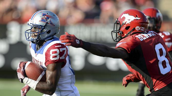 Calgary Stampeders' Bennett strips the ball from Montreal Alouettes' Collins as he runs towards the endzone during the second half of their CFL football game in Calgary
