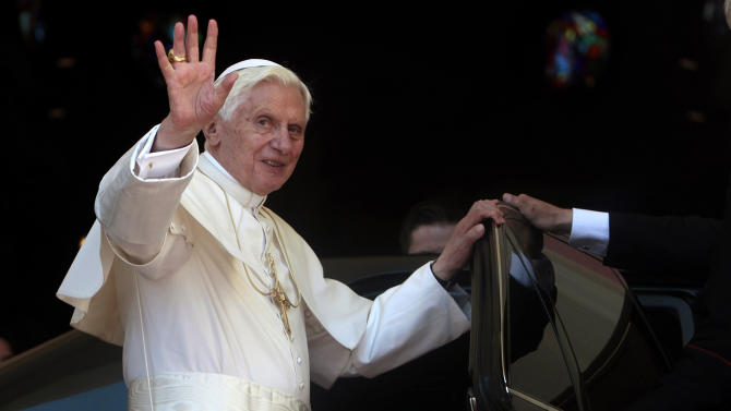 Pope Benedict XVI waves after praying before the Virgin of Charity of Cobre, Cuba's patron saint, in Santiago de Cuba, Cuba Tuesday March 27, 2012. Benedict is in the second day of his Cuban tour. (AP Photo/Esteban Felix, Pool)