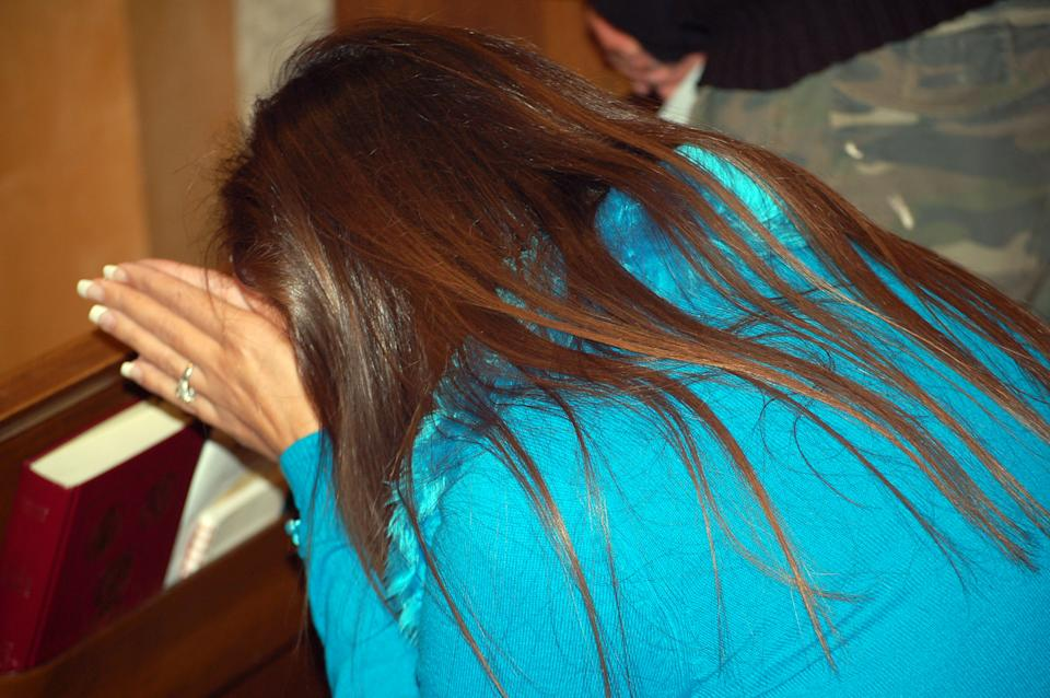 This Nov. 7, 2011 photo shows Reham Haddad, 40, praying after taking Communion at a mass in Arabic at Our Lady of Perpetual Help Byzantine Catholic Church in Albuquerque, N.M. Archdiocese of Santa Fe officials believe the Catholic Mass in Arabic was the first in New Mexico's history. (AP Photo/Russell Contreras)