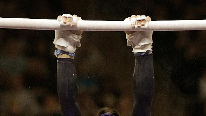 Women's All-Around winner Jordyn Wieber of the United States performs on the uneven bars during the American Cup gymnastics meet at Madison Square Garden in New York, Saturday, March 3, 2012.  (AP Photo/Kathy Willens)