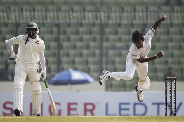 Sri Lanka's Lakmal bowls as Bangladesh's Al Hasan watches during the first day of their first test cricket match of the series in Dhaka