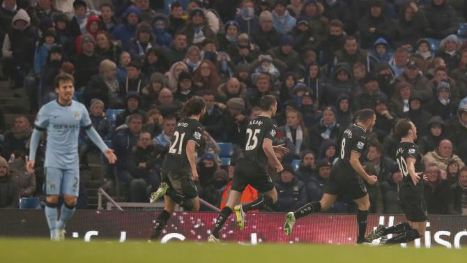 Burnley's Ashley Barnes celebrates with team-mates after scoring a goal against Manchester City during their English Premier League soccer match at the Etihad Stadium in Manchester