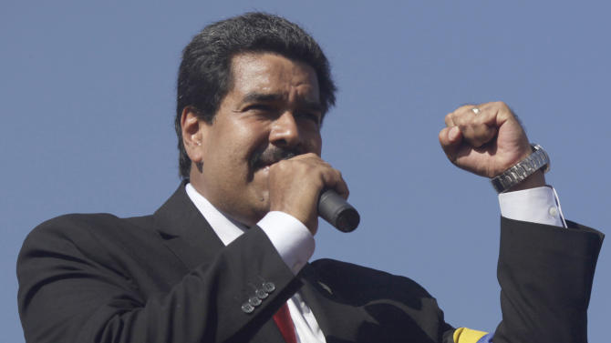 Venezuela's Vice President Nicolas Maduro speaks to the crowd at the military academy where the body of Venezuela's late President Hugo Chavez is lying in state in Caracas, Venezuela, Thursday, March 7, 2013. Maduro, Venezuela's acting president, said Chavez's  remains will be put on permanent display at the Museum of the Revolution, close to the presidential palace where Chavez ruled for 14 years. A state funeral for Chavez attended by some 33 heads of government is scheduled to begin Friday morning.  (AP Photo/Rodrigo Abd)