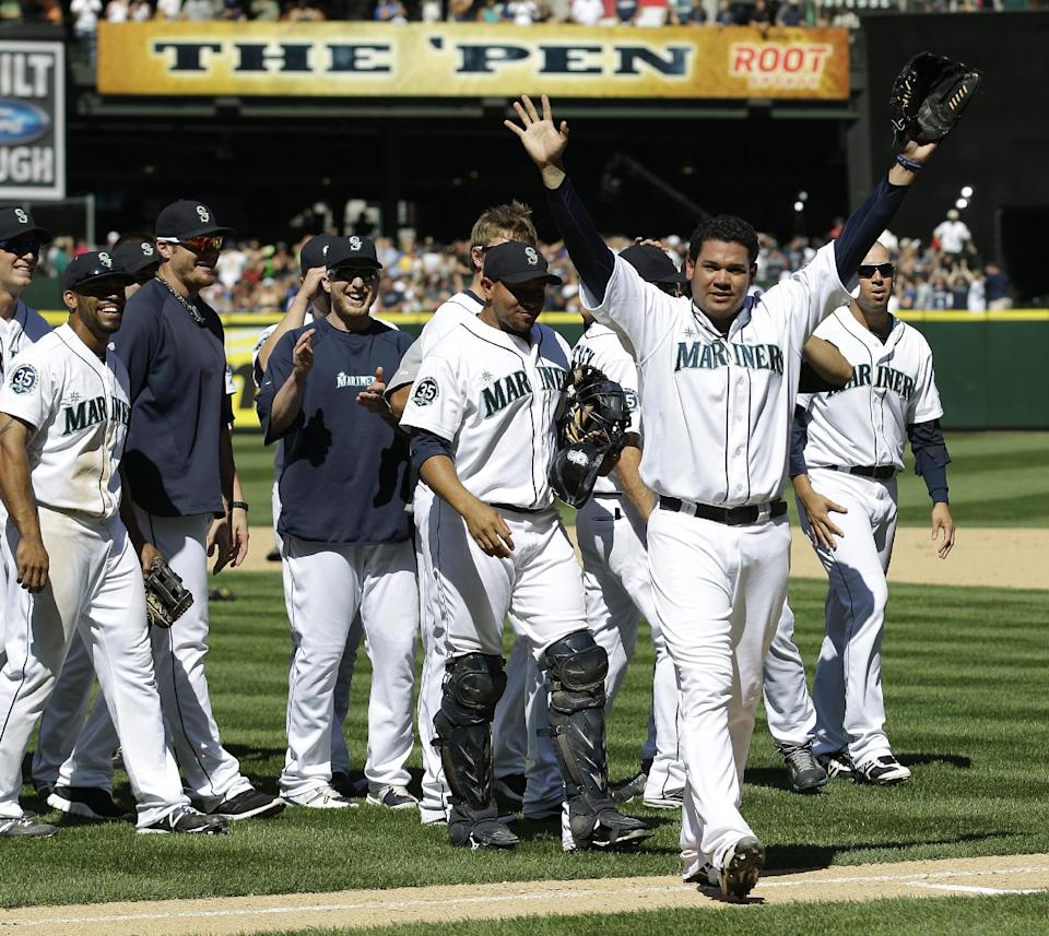 Seattle Mariners pitcher Felix Hernandez, front right, celebrates with teammates after tossing a perfect game in a 1-0 win over the Tampa Bay Rays in a baseball game, Wednesday, Aug. 15, 2012, in Seattle. (AP Photo/Ted S. Warren)