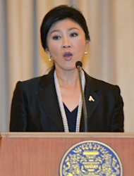 Thai Prime Minister Yingluck Shinawatra speaks during a press conference at Government House in Bangkok on November 18, 2013