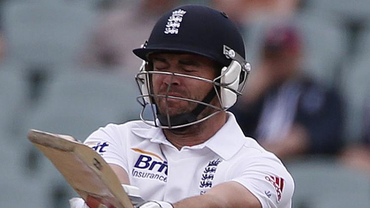 England's Anderson reacts as he is hit by a ball during the fifth day's play in the second Ashes cricket test against Australia at the Adelaide Oval