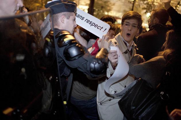 "A riot police officer moves back a Christian activist during a demonstration, in Paris, Thursday Oct. 27, 2011, in front of the Theatre de la ville, where the Italian director Romeo Castellucci's play ""On the Concept of the Face, Regarding the Son of God"" is being performed. Christian fundamentalists protest against the play featuring the face of Christ drizzled with fake excrement. (AP Photo / Thibault Camus)"