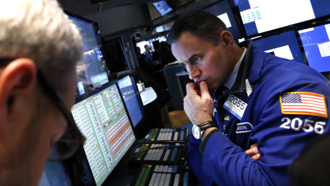 FILE - In this Friday, Jan. 24, 2014, file photo, specialist Jason Hardzewicz works on the floor of the New York Stock Exchange. Global stocks continued to fall on Monday, Jan. 27, 2014, extending a rout begun last week, as investors worried about a slowdown in growth in China and other developing economies that is causing big losses among emerging-market currencies. (AP Photo/Jason DeCrow, File)
