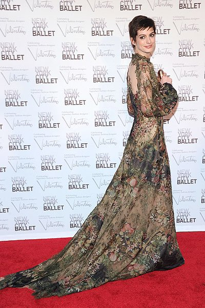 "Anne Hathaway looks stunning on the red carpet at New York City Ballet's fall gala on Sept. 20, 2012, in a sheer floral Valentino showstopper. The ""Dark Knight Rises"" actress' cute pixie haircut juxta"