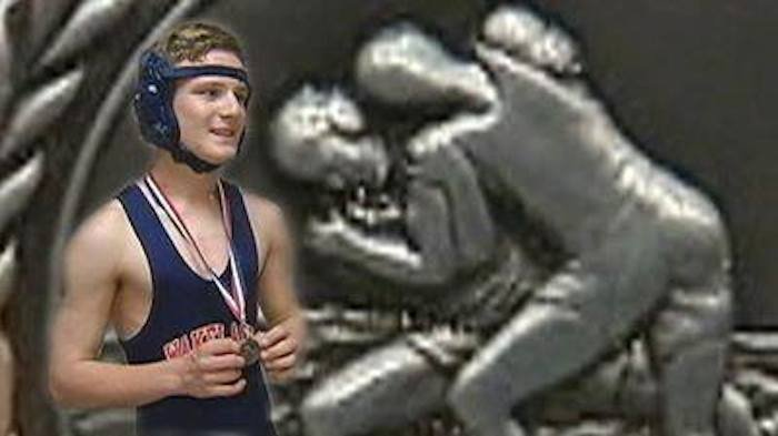 Wakeland wrestler Alex Chappell superimposed in front of his silver medal — Facebook