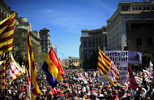 People protest during a May Day rally in the center of Barcelona, Spain, Tuesday, May 1, 2012. Tens of thousands of workers marked May Day in European cities Tuesday with a mix of anger and gloom over