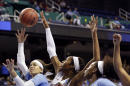 North Carolina's Jessica Washington, left, is blocked by South Carolina's Alaina Coates (41) as North Carolina's Stephanie Mavunga, right, looks on during the first half of a women's college basketball regional semifinal game in the NCAA Tournament Greensboro, N.C., Friday, March 27, 2015. (AP Photo/Gerry Broome)