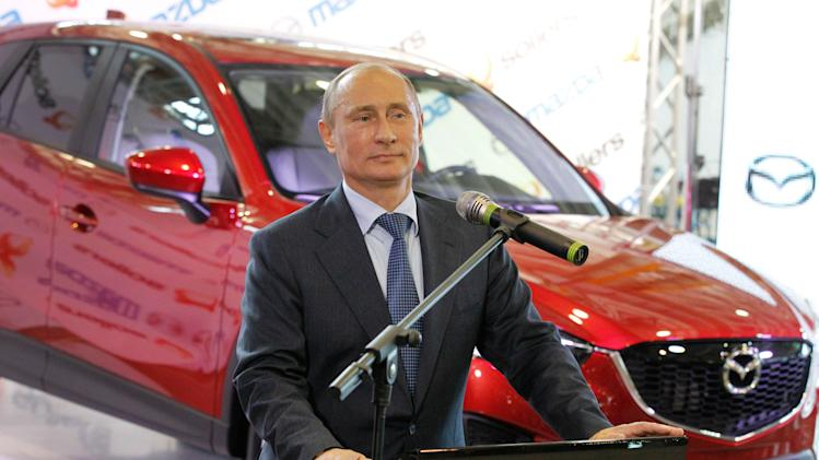 Russian President Vladimir Putin speaks at the opening of joint Russian-Japanese car assembling plant in Vladivostok on the eve of the opening of the APEC summit in Russian Pacific city of Vladivostok on Thursday, Sept. 6, 2012. (AP Photo/RIA Novosti Kremlin, Mikhail Klimentyev, Presidential Press Service)