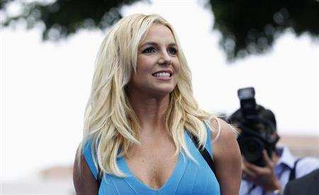 "Singer Britney Spears poses at the premiere of ""The Smurfs 2"" at the Regency Village theatre in Los Angeles"